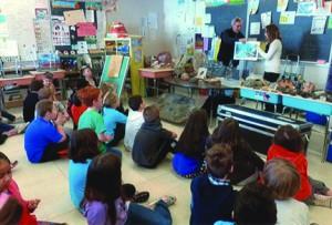 Esten School children watching Dinosaur presentation